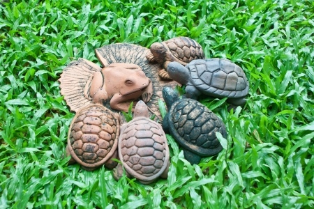 lotus leaf: A pottery of frog on lotus leaf and turtles Stock Photo