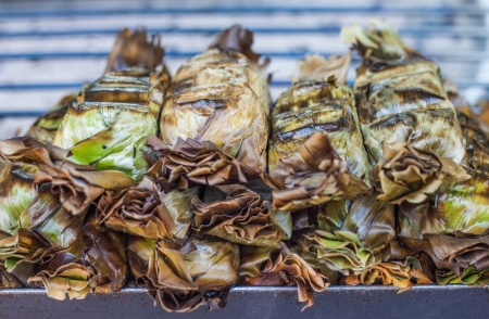 The roasted sticky rice with coconut milk and taro wrapped by banana leaf
