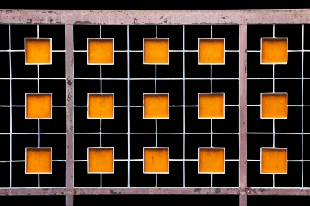Old metal fence with pattern of orange rectangle photo