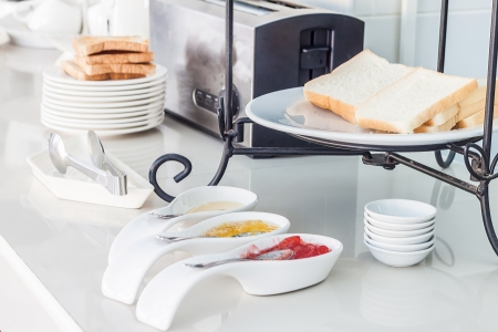 sweetened: Bread with two flavor jam and sweetened condensed milk is breakfast for guest of an hotel Stock Photo