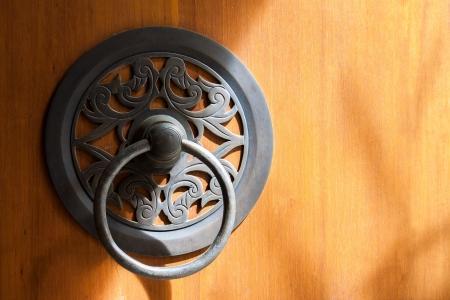 ligh: The vintage brass knocker door under ligh and shadow