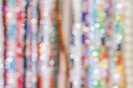 Blur background of colourful bead necklace photo