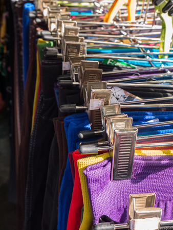 Hanging clothes for selling in market photo