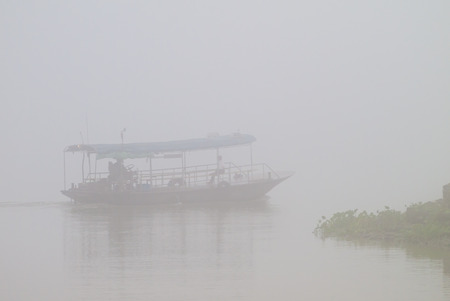 ferryboat: Ferryboat across canal among the mist Stock Photo