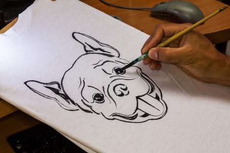 Artist draw french bulldog on white shirt photo