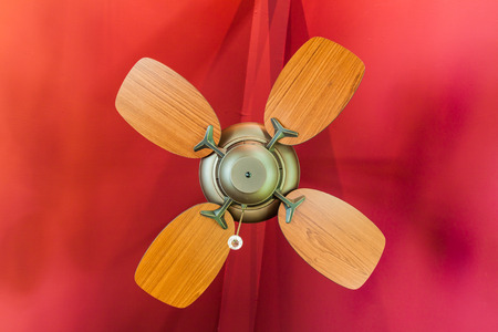 Vintage ceiling fan wit hred background photo