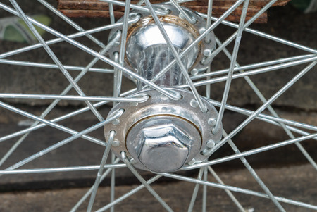 Close up of silver bicycle wheel photo