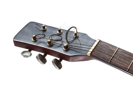 Close up of headstock of old guitar isolated on white background photo