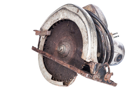 Old circular saw isolated on white with clipping path photo