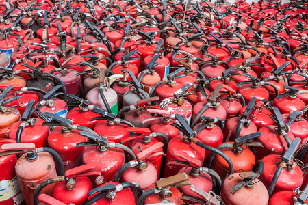fire extinguishers: Background with a lot of used fire extinguishers