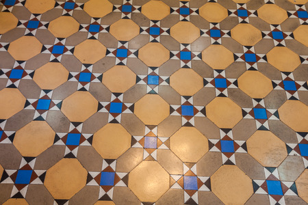 Pattern of colored cotta tile as floor in vintage house,Thailand  photo