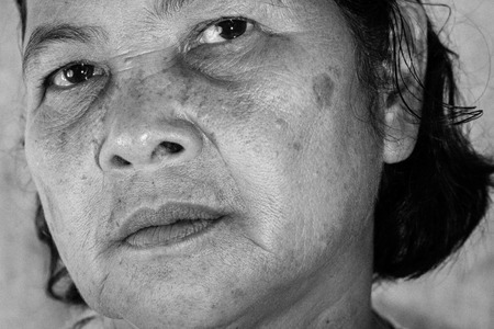 60 years old: Close up portrait of 60 years old Thai woman in black and white