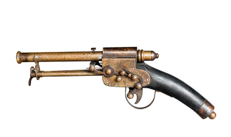 Old vintage gun isolated on white with clipping path photo