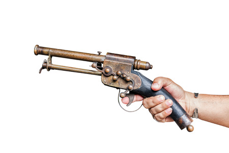 Old vintage gun in male hand isolated on white with clipping path photo