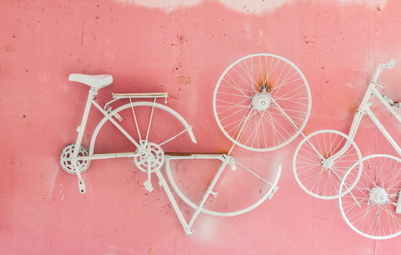 Part of bicycle hang on pink wall background Stock Photo