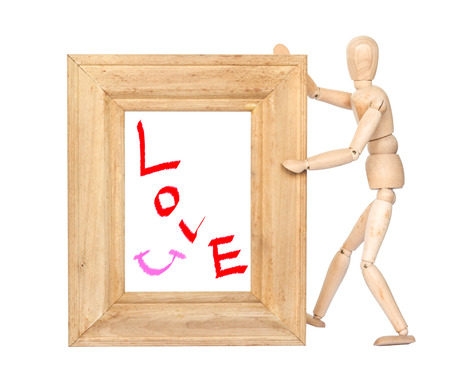 Wooden figure hold square wooden frame with love and smile inside isolated on white photo