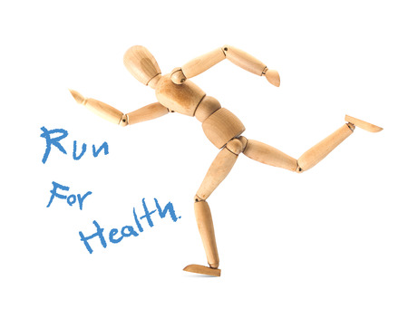 Wooden figure on running pose isolated on white,running for health concept photo