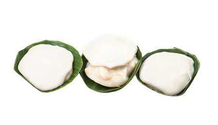 Thai pudding with coconut topping isolated on white background