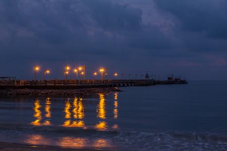 Lighthouse at twilight time near the beach,Thailand