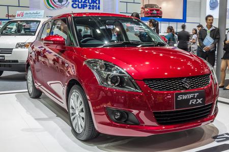 nontaburi: NONTABURI, THAILAND - 4 DEC : Suzuki Swift RX a compact car showed in 31th Thailand International Motor Expo on 4 December 2014