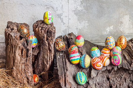 hay: Set of colorful easter egg on old log and hay stack