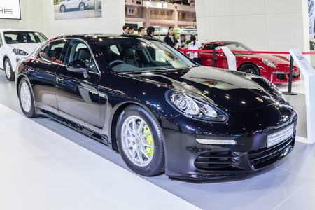 fuel economy: Nonthburi,Thailand - March 26th, 2015: Porsche Panamera Es Hybrid, a plug-in hybrid that promises unsurpassed fuel economy and emissions,showed in Thailand the 36th Bangkok International Motor Show on 26 March 2015