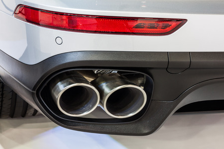 exhaust pipe: Nonthburi,Thailand - March 26th, 2015: Exhaust pipe of  Porsche Cayenne S Hybrid,showed in Thailand the 36th Bangkok International Motor Show on 26 March 2015