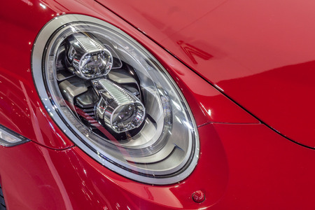exceptional: Nonthburi,Thailand - March 26th, 2015: Headlight of  Porsche 911 Carrera 4 GTS ,an exceptional performance carr,showed in Thailand the 36th Bangkok International Motor Show on 26 March 2015 Editorial