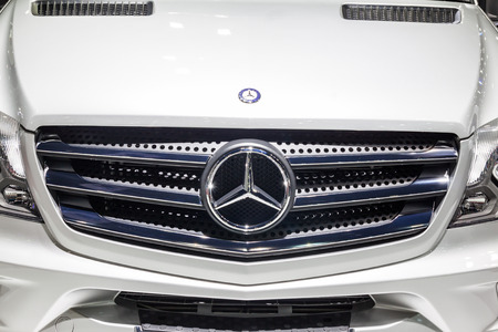 airstream: Nonthaburi,Thailand - March 26th, 2015: Benz logo at front grill of Airstream Interstate Ext, a perfect for travelers in search of versatility and space,showed in Thailand the 36th Bangkok International Motor Show on 26 March 2015 Editorial