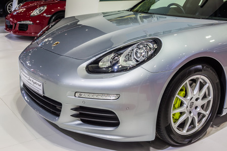 unsurpassed: Nonthaburi,Thailand - March 26th, 2015: Porsche Panamera Se Hybrid, a plug-in hybrid that promises unsurpassed fuel economy and emissions,showed in Thailand the 36th Bangkok International Motor Show on 26 March 2015