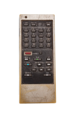 Old remote control for television isoated on white with clipping path Imagens