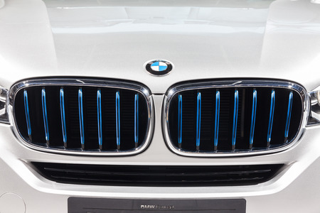 showed: Nonthaburi,Thailand - March 26th, 2015: BMW logo at front grill of X5 eDrive,showed in Thailand the 36th Bangkok International Motor Show on 26 March 2015