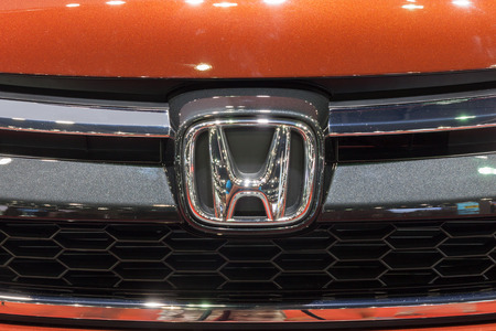 showed: Nonthaburi,Thailand - March 26th, 2015: Honda logo at front grill of CR-V,showed in Thailand the 36th Bangkok International Motor Show on 26 March 2015
