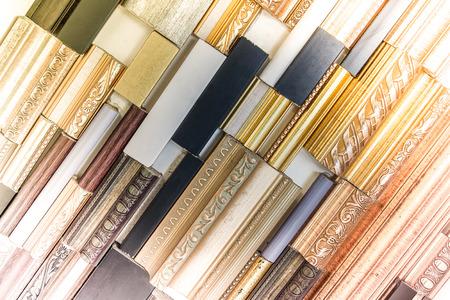 samples: Hanging sample wooden frame corner for showing customer in frame shop Stock Photo