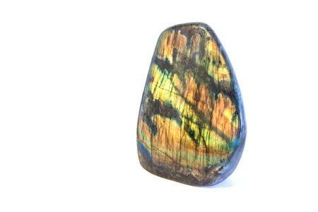 labradorite: Colorful raw labradorite gemstone isolated on white background Stock Photo