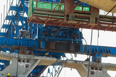girder: Bridge Girder Machine at highway construction site in Thailand