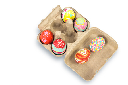 Colorful easter egg in pulp box on white background with clipping path