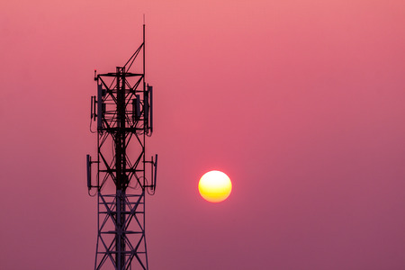 communication tower: Silhouette of communication tower on sunset background