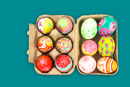 pulp: Top view of colorful easter egg in pulp box on green background with clipping path