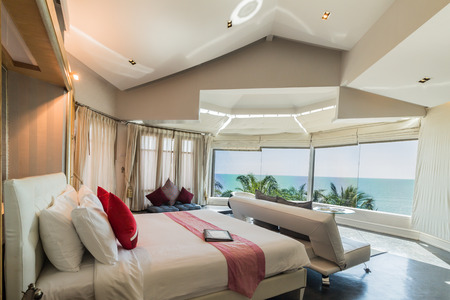 Modern style of living room with bed and sea view in resort ,Thailand