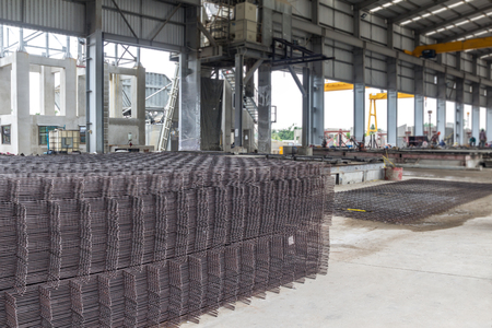 reinforce: Steel rods or bars stack,in factory, used to reinforce concrete.