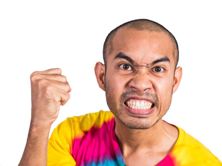 Asian man clench his hand with angry face isolated on white background with clipping path