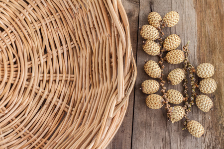 Closeup rattan fruit with wicker basket on wooden background Stock Photo