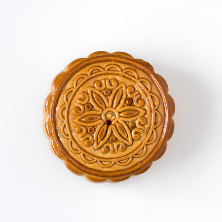 Mid autumn festival dessert, flower pattern moon cakes on white background with clipping path
