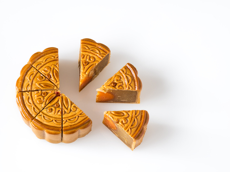Mid autumn festival dessert, flower pattern moon cakes cut in pieces on white background with soft shadow