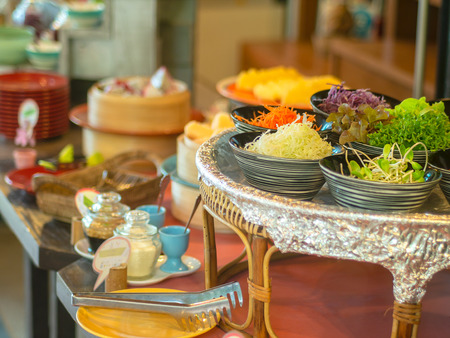 Vegetable salad in bowl in wooden tray with another food for breakfast prepare for guest of hotel. Stock Photo