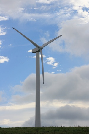 Wind turbine to generate electricity with blue sky in the background