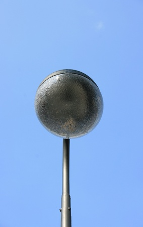 a street lamp with a large, spherical glass body