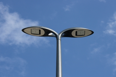 Street light with two lamps, blue sky in the background