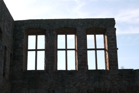 House wall with three windows in the back light Stock Photo